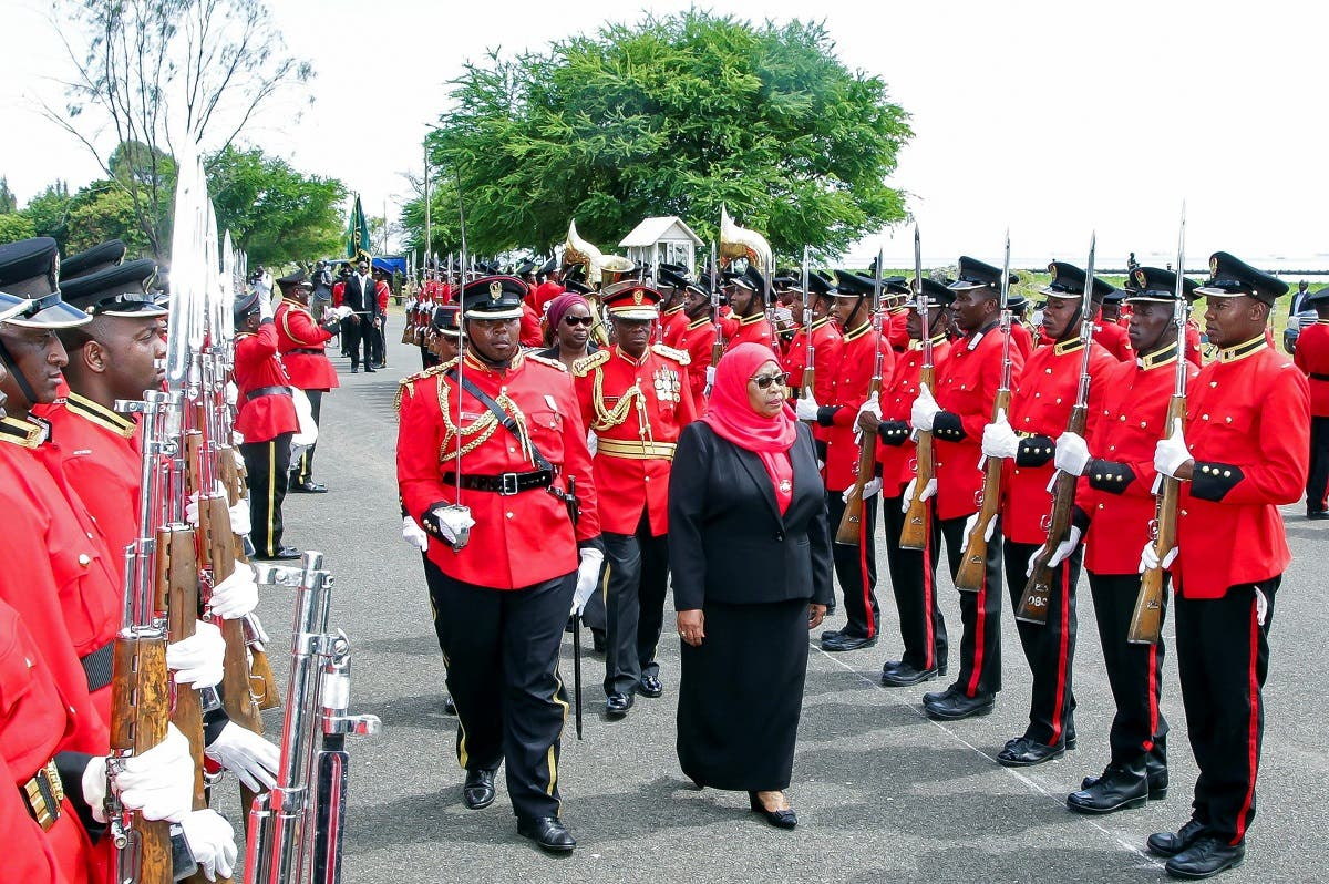 Tanzania's new President Samia Suluhu Hassan inspects a guard of honor mounted by the Tanzania Peoples Defense Forces after she was sworn into office following the death of her predecessor at State House in Dar es Salaam, Tanzania, on March 19, 2021. (Reuters)