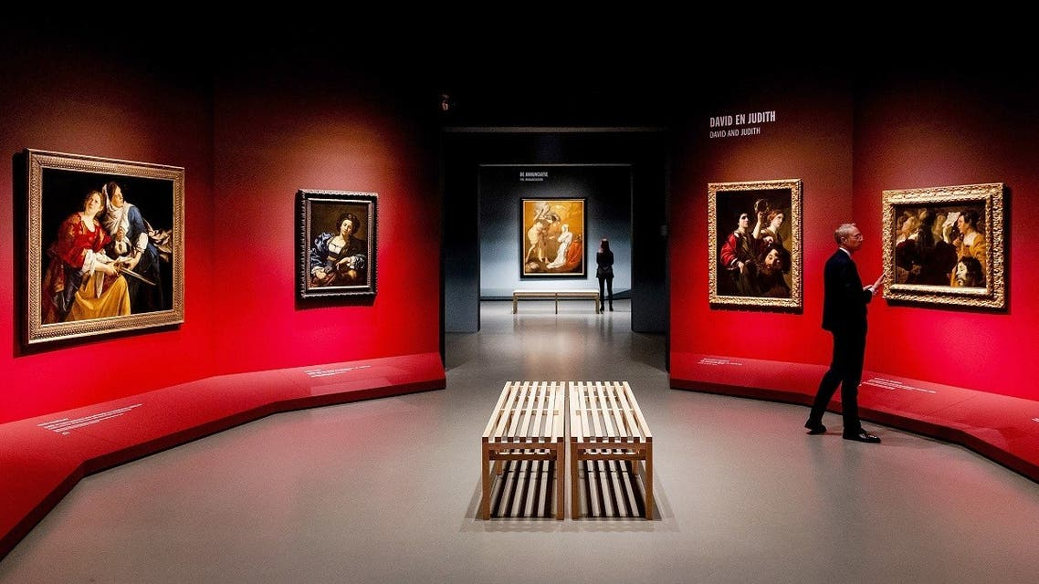 """Italy's Caravaggio's master piece """"The burial of Christ"""" (C) is displayed at the exhibition """"Utrecht, Caravaggio and Europe""""at the Centraal Museum in Utrecht on December 13, 2018. (AFP)"""