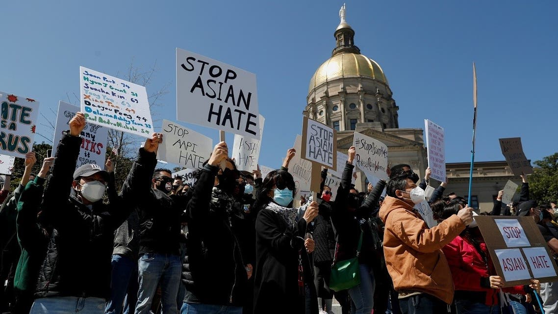 """People hold placards during a """"Stop Asian Hate"""" rally, following the deadly shootings, in Atlanta, Georgia, US, on March 20, 2021. (Reuters)"""