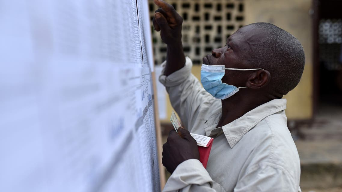 A man searches for his name on a voter registration list at a polling station during the presidential election in Brazzaville, Republic of Congo March 21, 2021. (Reuters)