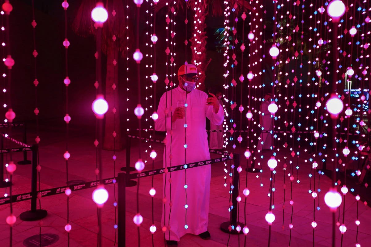 A visitor looks on during 'Noor Riyadh' festival of light, in Riyadh, Saudi Arabia March 19, 2021. (Reuters)