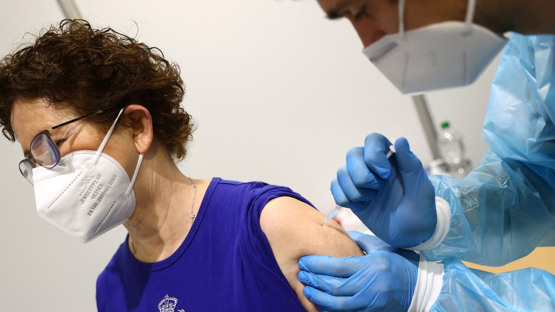 A woman gets her AstraZeneca COVID-19 vaccine at the local vaccination centre as the spread of the coronavirus disease (COVID-19) continues in Hagen, Germany. (Reuters)