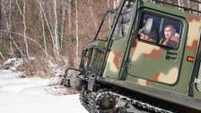 Russia's Putin pilots bumpy all-terrain rig on Siberian holiday with defense minister