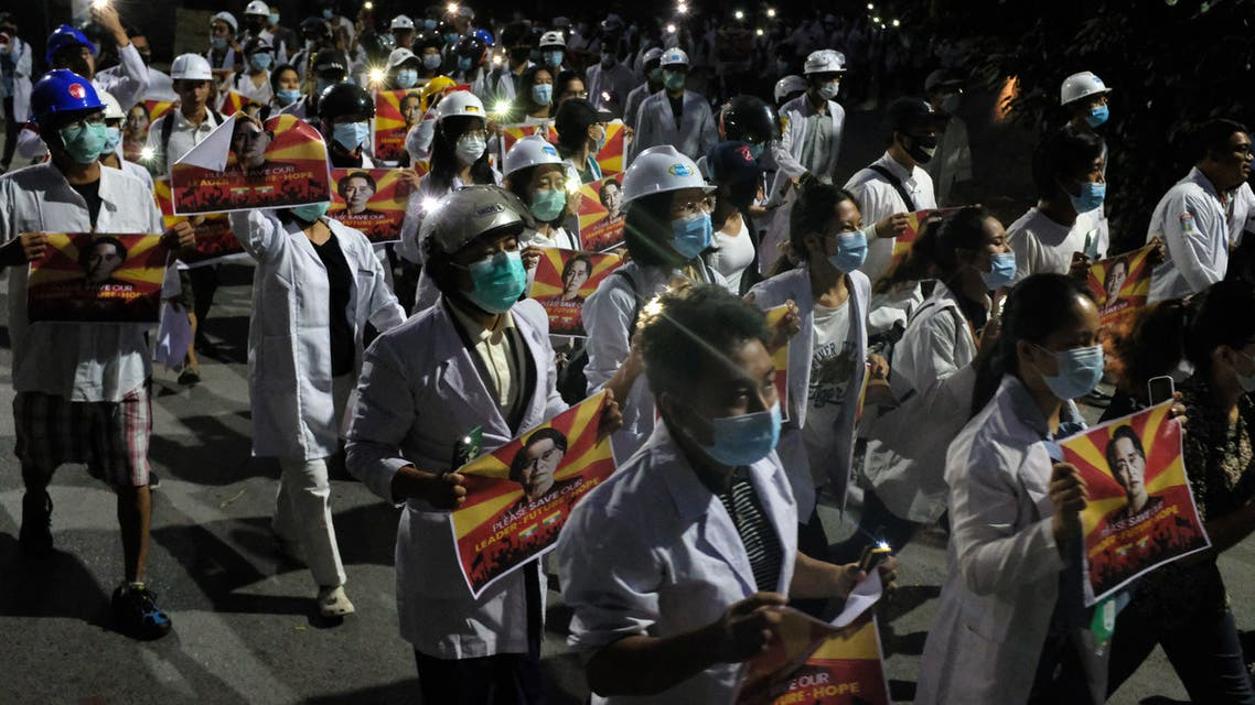 Medical staff and students take part in an early morning protest against the military coup and crackdown by security forces on demonstrations in Mandalay on March 21, 2021. (AFP)