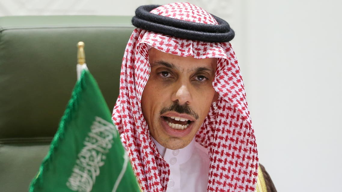 Saudi Foreign Minister Faisal bin Farhan (L) speaks during a press conference in the capital Riyadh on March 22, 2021, announcing an offer of a ceasefire with Yemen's Huthi rebels. Saudi Arabia offered Yemen's Huthi rebels a comprehensive ceasefire, among a series of proposals aimed at ending a catastrophic six-year conflict. The proposals include a comprehensive ceasefire across the country under the supervision of the United Nations, a government statement said.