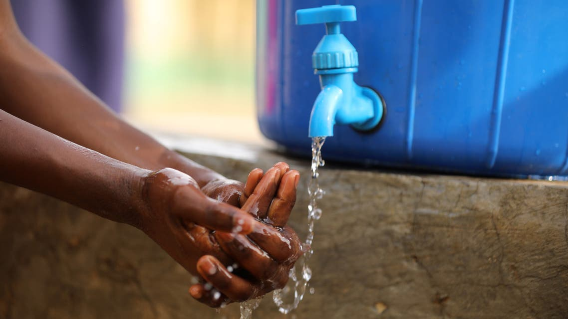 A student washes her hands after clean up at a school in Abuja, Nigeria March 20, 2020. (File photo: Reuters)