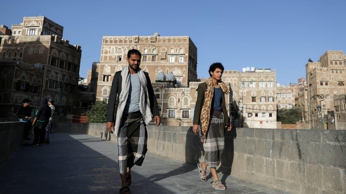 People walk in the old quarter of Sanaa, Yemen March 22, 2021. (Reuters)