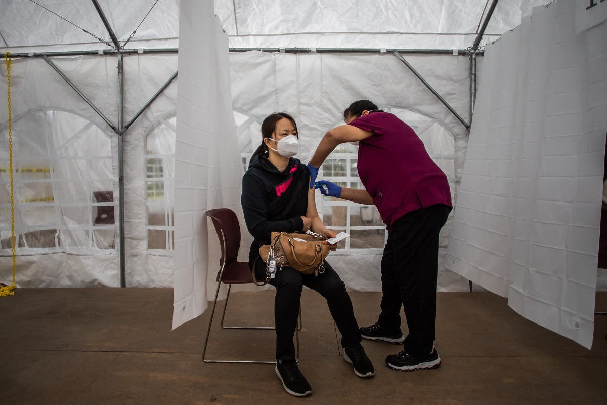 A nurse administers the Moderna COVID-19 vaccine at Kedren Community Health Center, in South Central Los Angeles, California on February 16, 2021. (Apu Gomes/AFP)