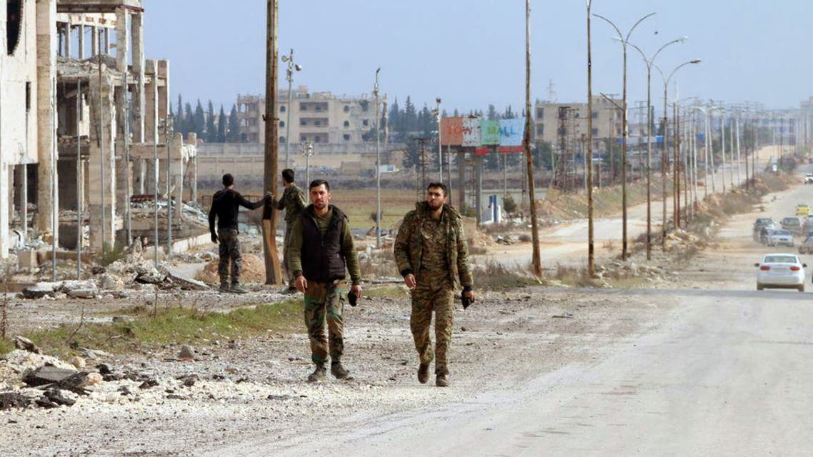 Syrian army soldiers walk along a street in Aleppo province, February 17, 2020. (Reuters)
