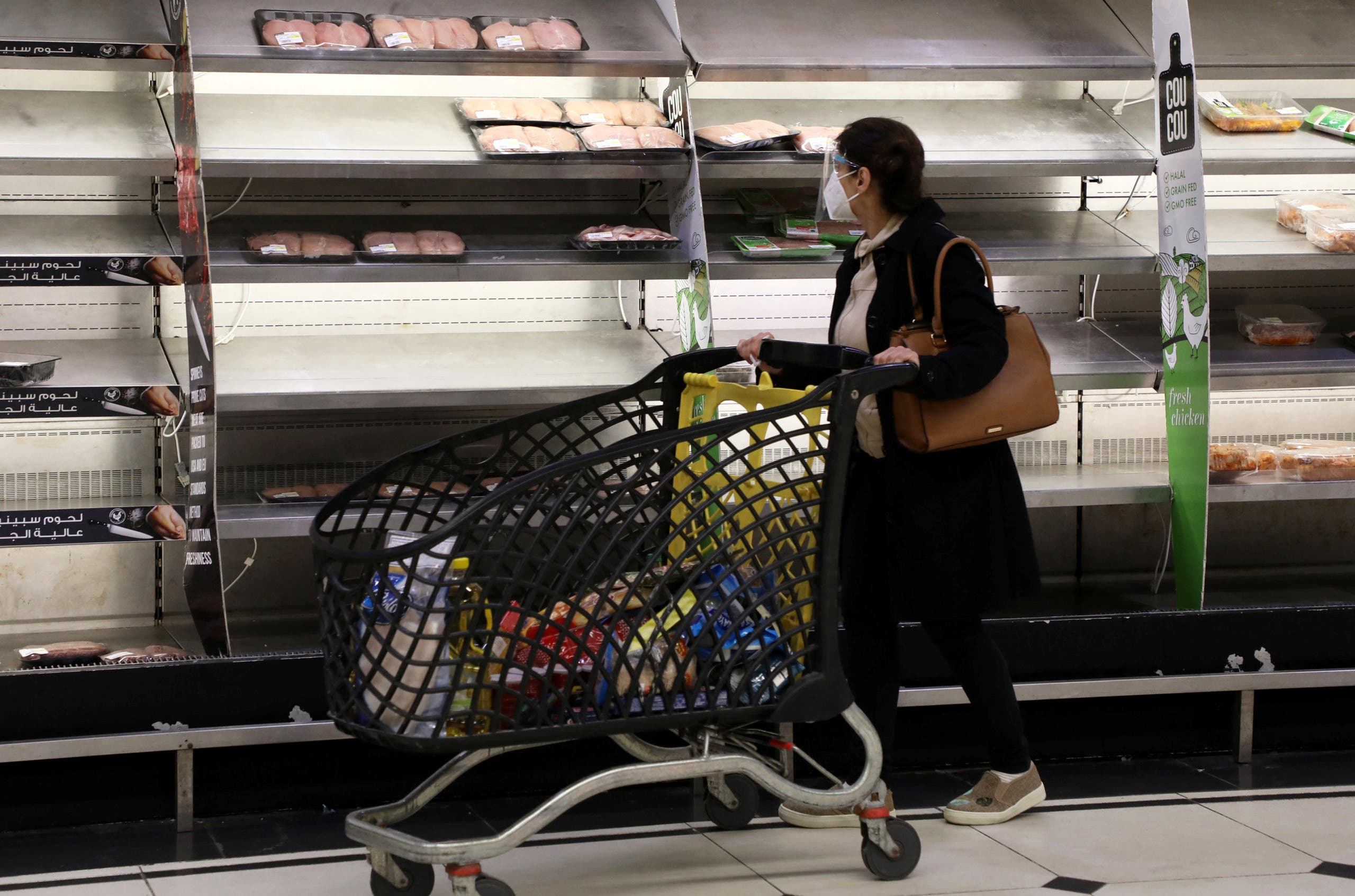 A shopper walks past near-empty shelves at a supermarket in Beirut, Lebanon March 16, 2021. Picture taken March 16, 2021. (Reuters)