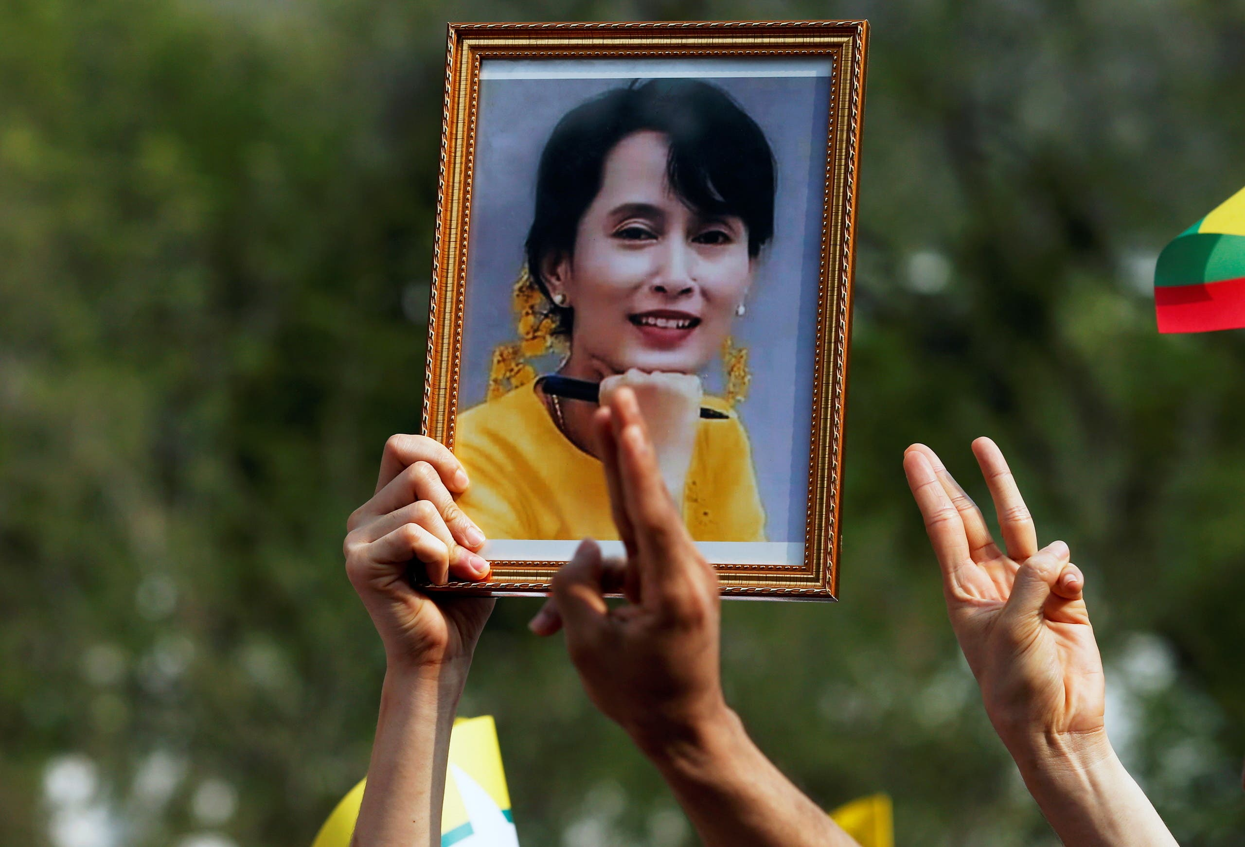 A person holds a picture of leader Aung San Suu Kyi as Myanmar citizens protest against the military coup in front of the UN office in Bangkok, Thailand February 22, 2021. (File photo: Reuters)