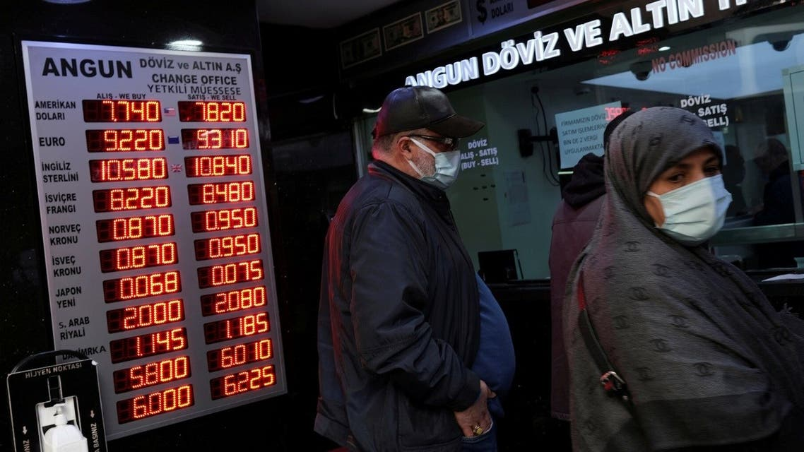 People wait to change money at a currency exchange office in Istanbul, Turkey, on March 22, 2021. (Reuters)
