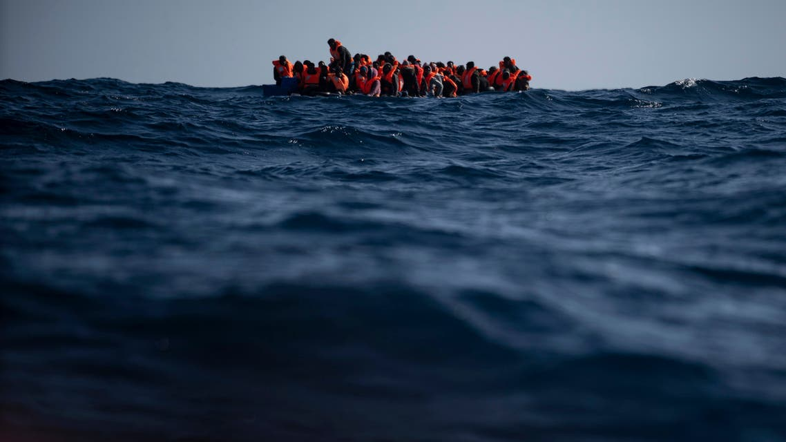 Migrants from Eritrea, Egypt, Syria and Sudan, wait to be assisted by aid workers of the Spanish NGO Open Arms, after fleeing Libya on board a precarious wooden boat in the Mediterranean sea, about 110 miles north of Libya. (File photo: AP)