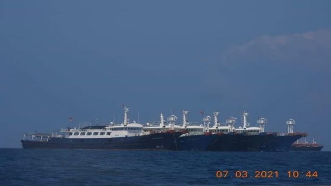 Some of the about 220 Chinese vessels reported by the Philippine Coast Guard, and believed to be manned by Chinese maritime militia personnel, are pictured at Whitsun Reef, South China Sea, March 7, 2021. Picture taken March 7, 2021. (Reuters)