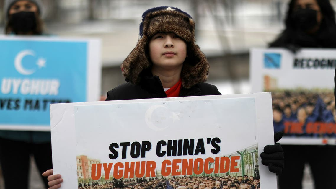 FILE PHOTO: People take part in a rally to encourage Canada and other countries as they consider labeling China's treatment of its Uighur population and Muslim minorities as genocide, outside the Canadian Embassy in Washington, D.C., U.S. February 19, 2021. (File photo: Reuters)