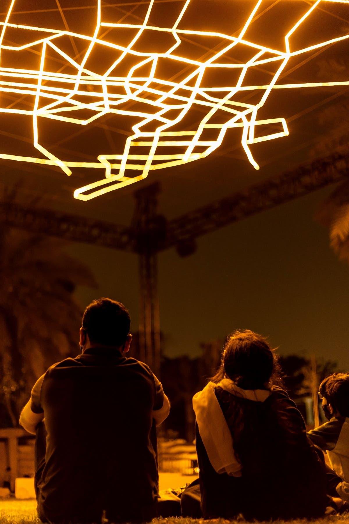 Families in Riyadh enjoying VOUW'S artwork. (Courtesy: Riyadh Art 2021)