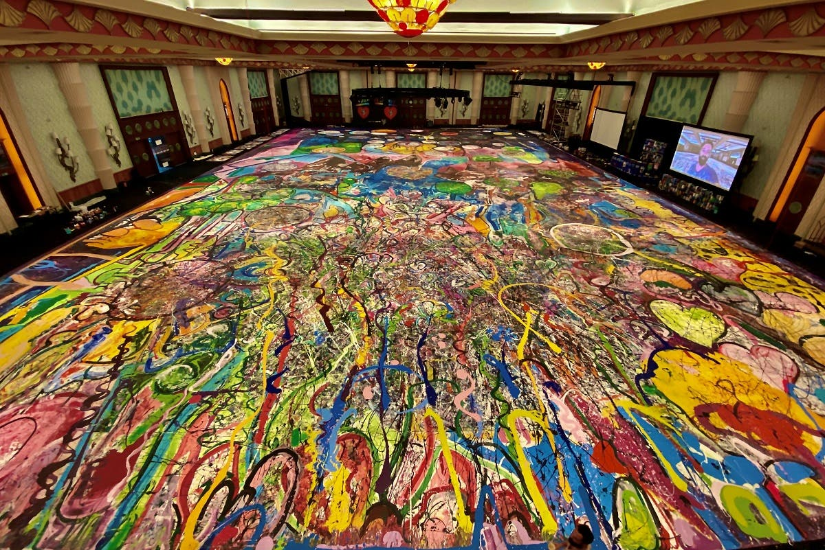 A view shows the giant canvas painted by British artist Sacha Jafri, who partnered with UNICEF and UNESCO looking to raise up $30 million from selling the painting and donating them to children's charities, at The Atlantis hotel in Dubai, UAE, on September 20, 2020. (Reuters)