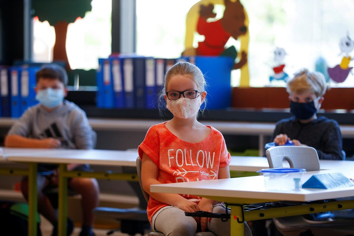 Children wearing protective face masks sit in a classroom at a primary school, as Austrian schools reopen for pupils aged roughly six to 14, during the global coronavirus disease (COVID-19) outbreak, in Brunn am Gebirge, Austria. (Reuters)