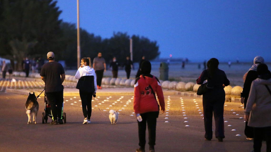 Residents walk on a waterfront promenade in Kuwait City on March 23, 2021, as authorities allowed people to exercise for two hours amid a nationwide curfew due to the COVID-19 pandemic. (File photo: AFP)
