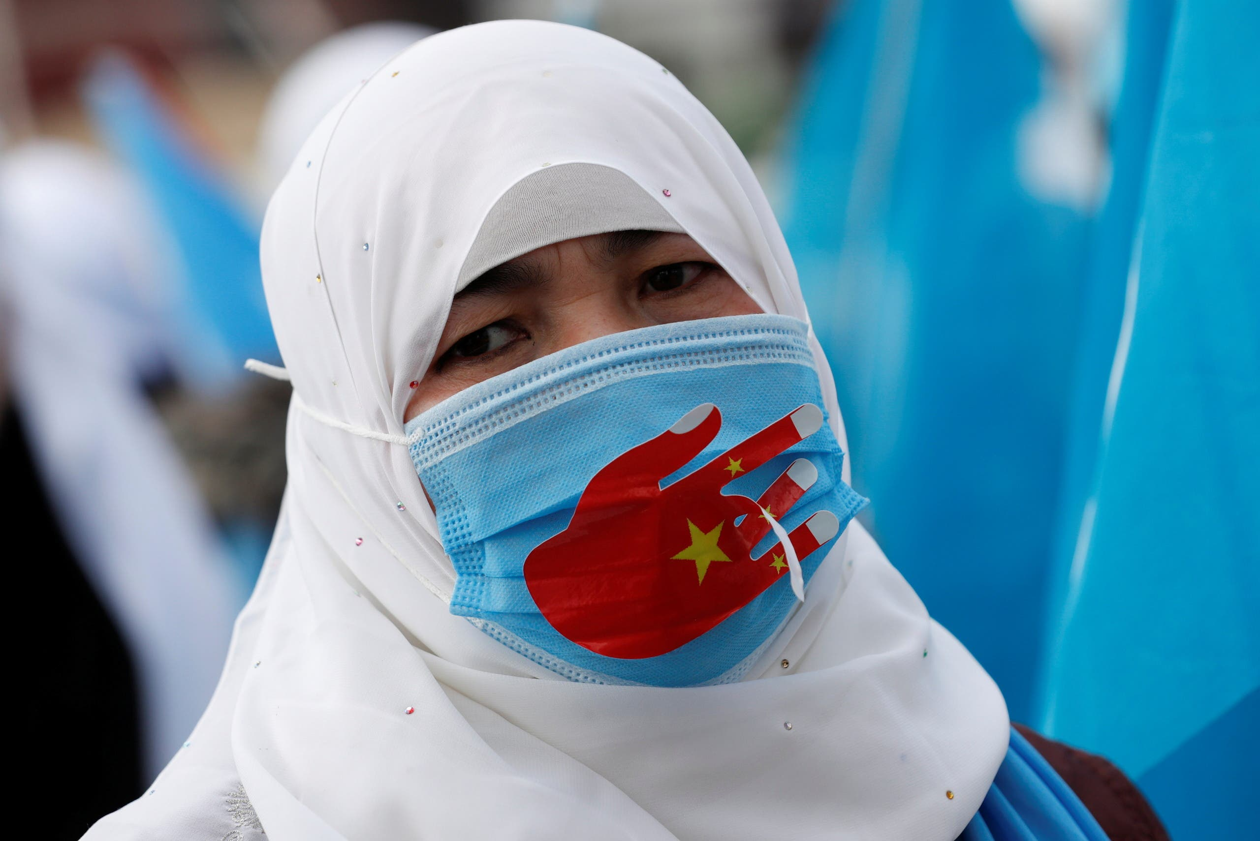 An Ethnic Uighur demonstrator wearing a protective face mask to prevent the spread of the coronavirus disease (COVID-19), takes part in a gathering on the occasion of International Women's Day to protest China's treatment of Uighurs, in Istanbul, Turkey March 8, 2021. (File photo: Reuters)