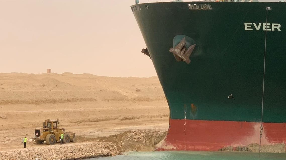 A container ship ran aground in the Suez Canal, blocking vessels passing through. (Twitter)