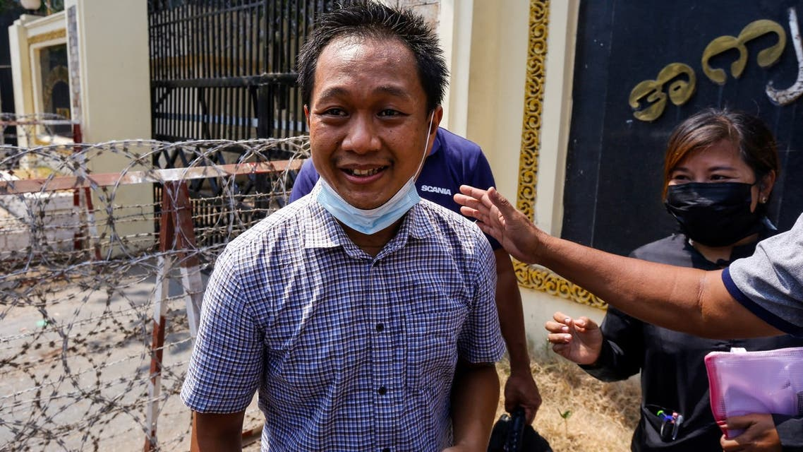 Associated Press (AP) photographer Thein Zaw smiles outside Insein prison in Yangon on March 24, 2021, after being released with coup detainees who had been held for taking part in demonstrations against the military coup. (AFP)