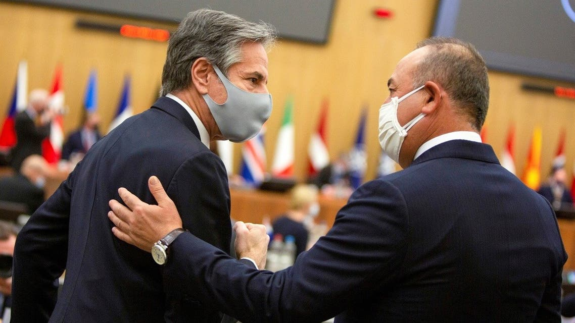 US Secretary of State Antony Blinken speaks with Turkish Foreign Minister Mevlut Cavusoglu during a meeting of NATO foreign ministers at the NATO headquarters in Brussels, Belgium, March 23, 2021. (Reuters)