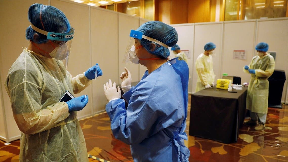 Medics are seen at a coronavirus disease test center at Geo Connect Asia trade conference in Singapore March 24, 2021. (Reuters/Edgar Su)