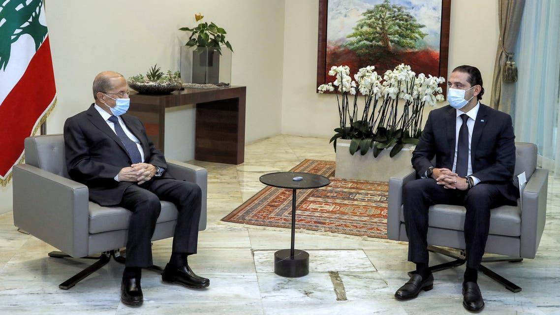رئيس جمهورية لبنان ميشال عون والحكومة سعد الحريري (أرشيفية- فرانس برس)