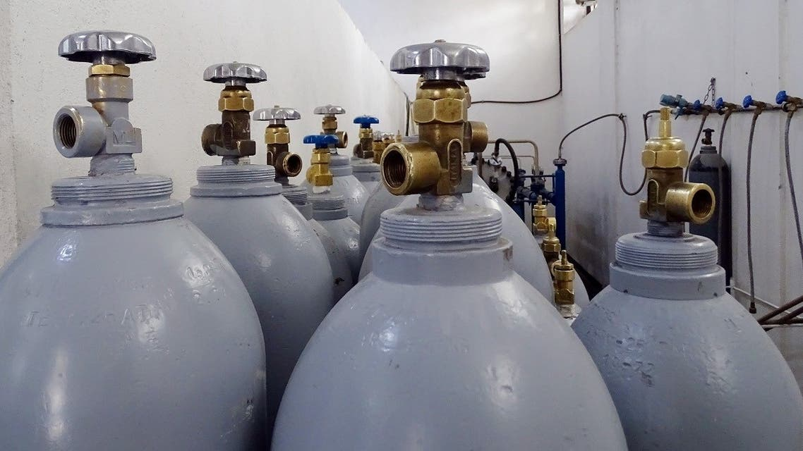 Oxygen cylinders are pictured inside a warehouse at a hospital in Damascus, Syria in this handout picture released by Sana on March 23, 2021. (SANA/Handout via Reuters)