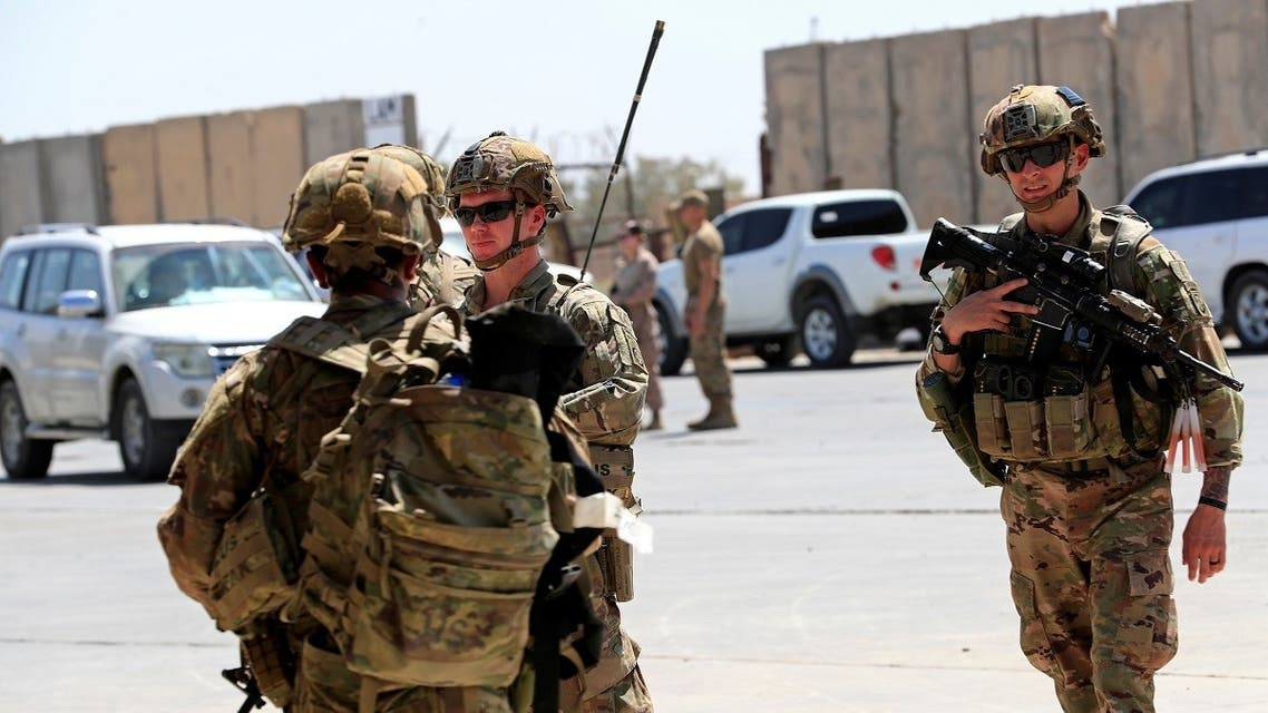 US soldiers at a handover ceremony of Taji military base from US-led coalition troops to Iraqi security forces, in the base north of Baghdad, Iraq Aug. 23, 2020. (Reuters)