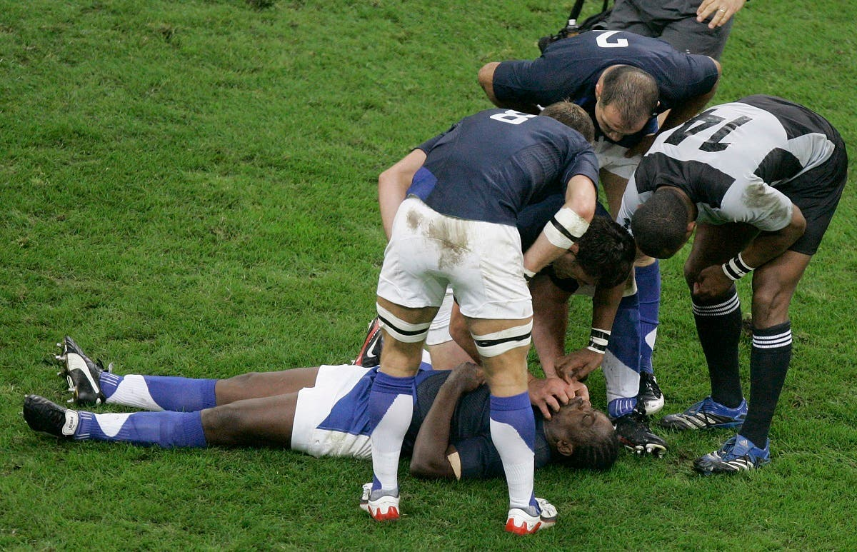 Serge Betsen of France lays on the pitch after taking a knock during the Rugby World Cup quarterfinal match between France and New Zealand at the Millennium Stadium in Cardiff, Wales, in Oct. 6, 2007. (AP)