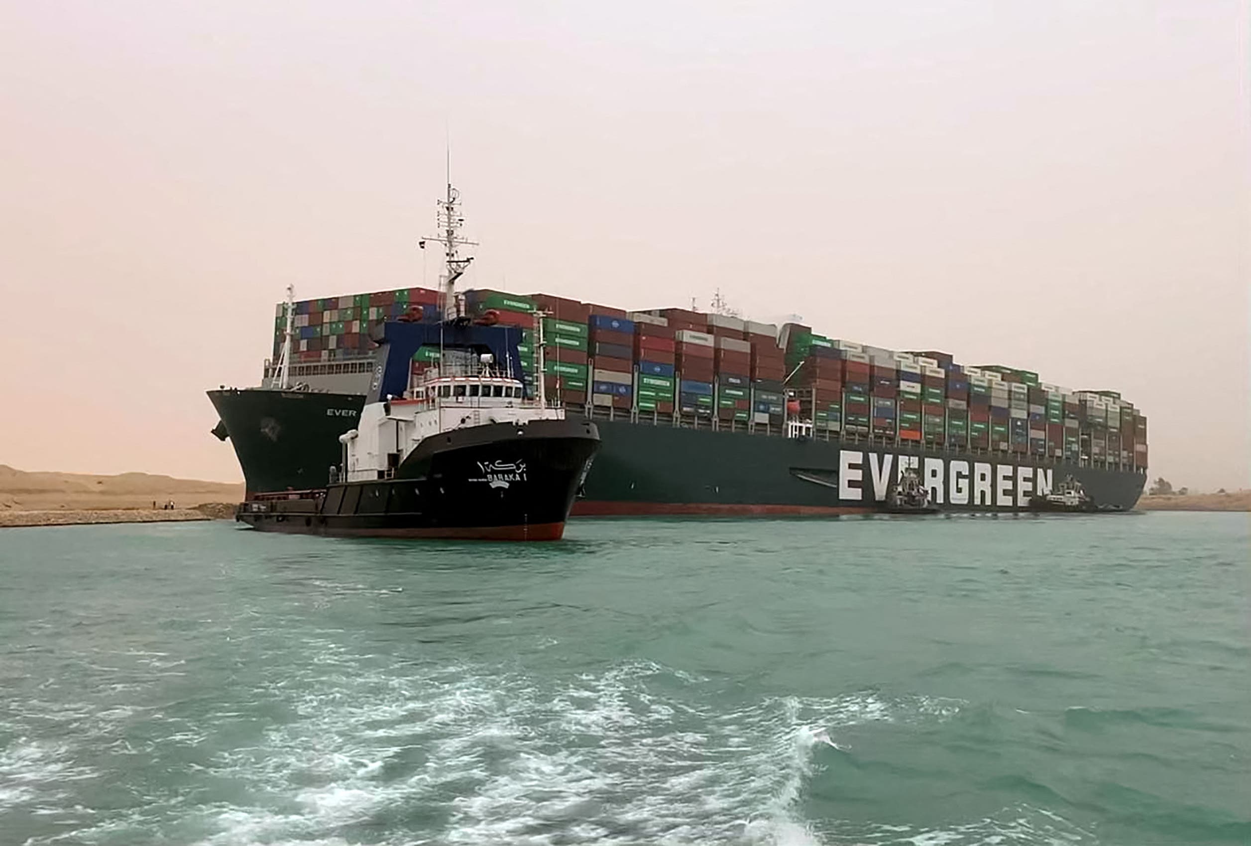 The Taiwan-owned MV Ever Given (Evergreen), a 400-meter- (1,300-foot-) long and 59-meter wide vessel, lodged sideways and impeding all traffic across the waterway of Egypt's Suez Canal. (AFP)
