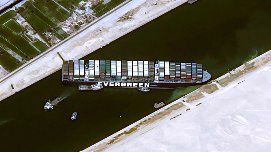 This handout satellite images courtesy of Cnes 2020 released on March 25, 2021 by Airbus DS shows the Taiwan-owned MV 'Ever Given' (Evergreen) container ship, a 400-metre- (1,300-foot-)long and 59-metre wide vessel, lodged sideways and impeding all traffic across the waterway of Egypt's Suez Canal. (AFP)