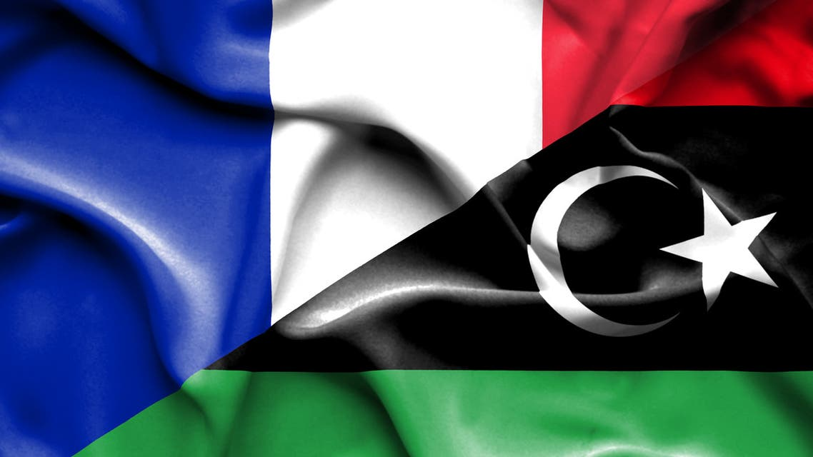 Libya and France two flags together realations textile cloth fabric texture stock photo
