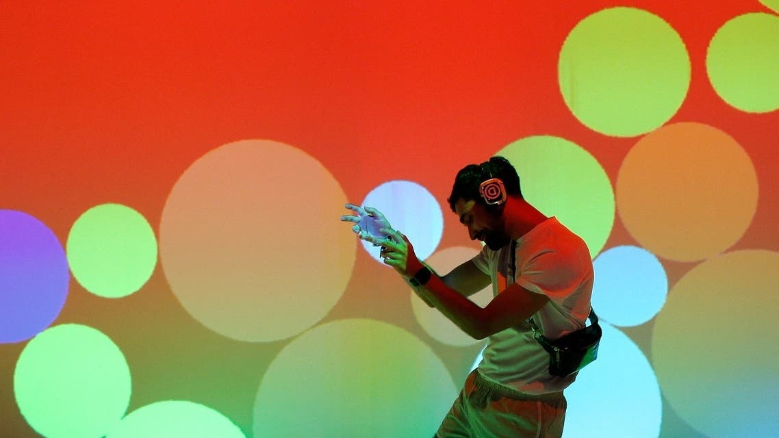 In this file photo taken on July 18, 2019 a reveller enjoys a multimedia performance at the 2019 Sonar Festival in Barcelona. (AFP)