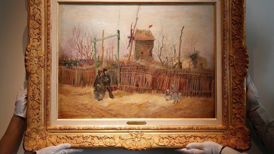 otheby's personnel display 'Scene de rue à Montmartre' (Street scene in Montmartre), a painting by Dutch master Vincent van Gogh at Sotheby's auction house in Paris. (AP)