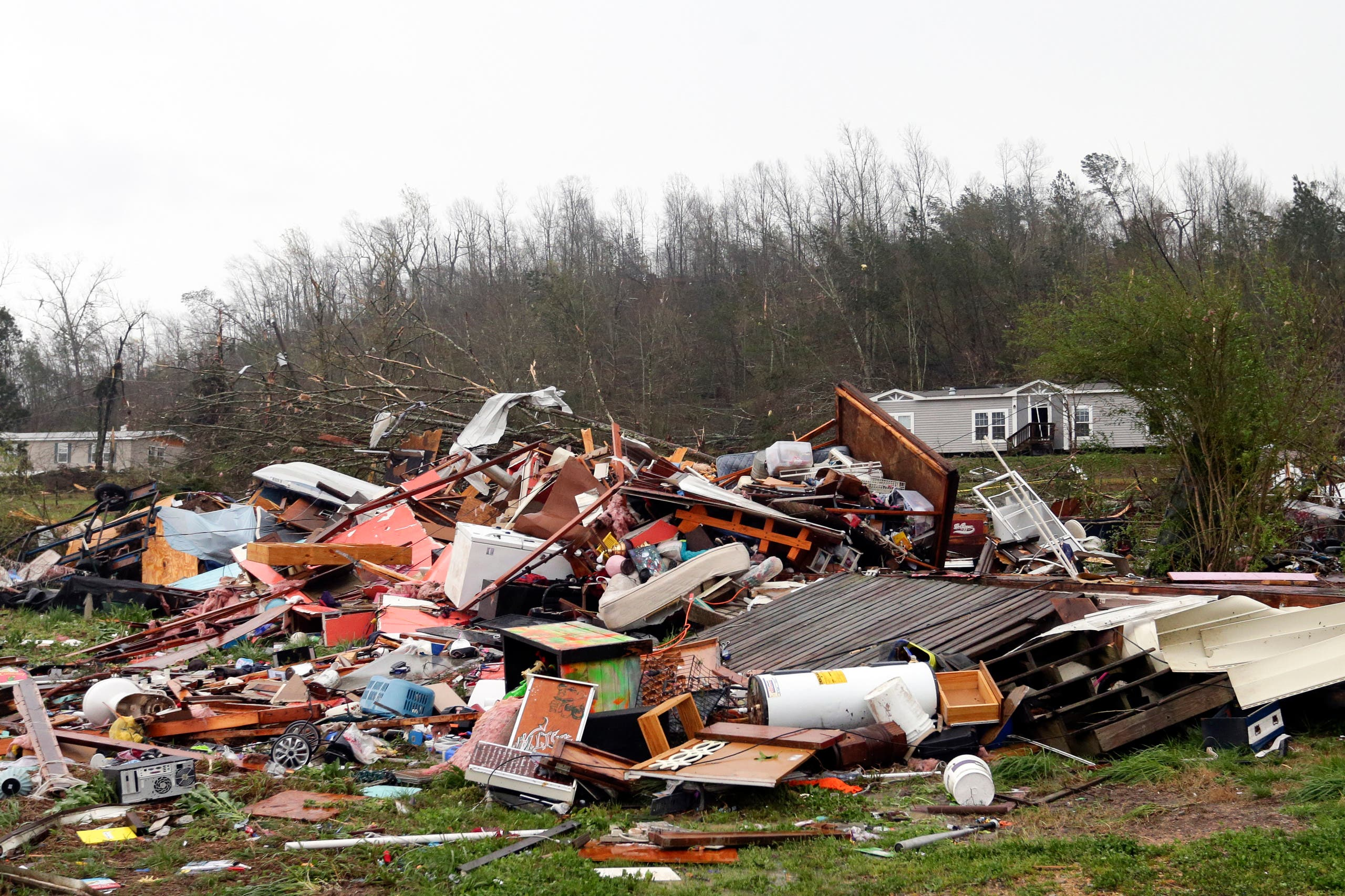 Piles of debris remain after a tornado touched down killing several people and damaging multiple homes, Thursday, March 25, 2021 in Ohatchee, Ala. (AP)