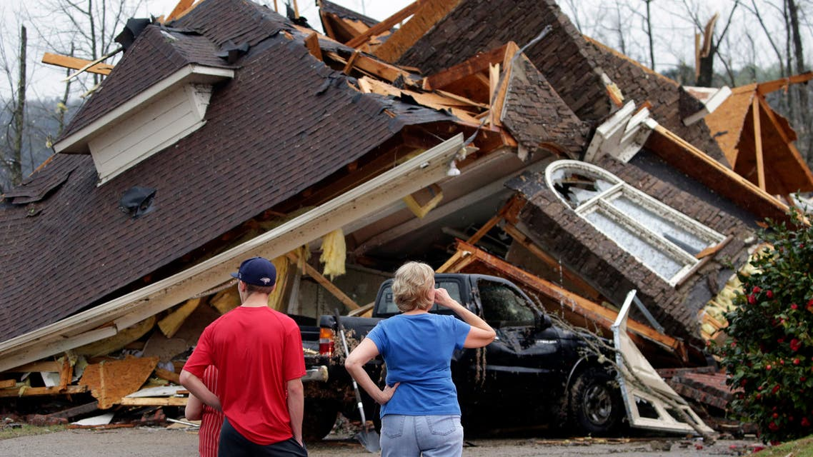 Residents survey damage to homes after a tornado touched down south of Birmingham, Ala. in the Eagle Point community damaging multiple homes, Thursday, March 25, 2021. (AP)