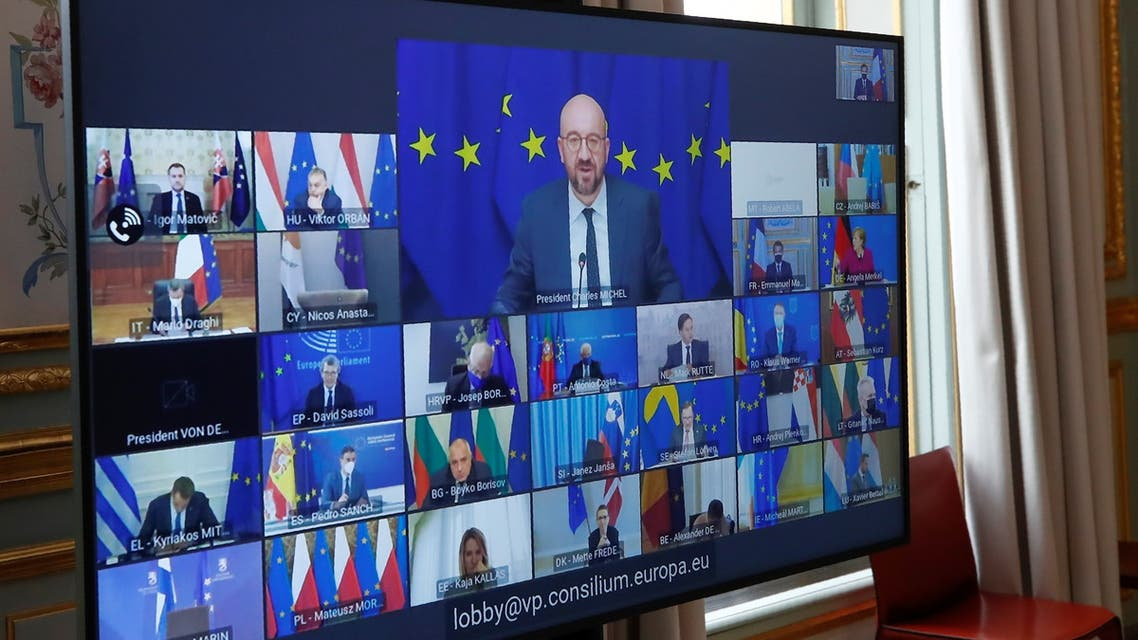 European Council President Charles Michel speaks during an EU summit video conference, as seen on screen at the Elysee Palace in Paris, France. (Reuters)