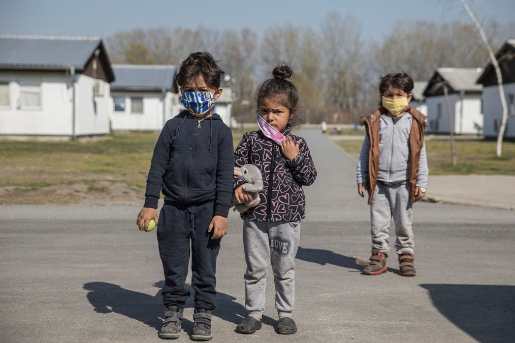 Children wear protective face masks in a camp for refugees and migrants as Serbia begins vaccinating migrants against the coronavirus disease (COVID-19), Belgrade, Serbia, March 26, 2021. (Reuters)