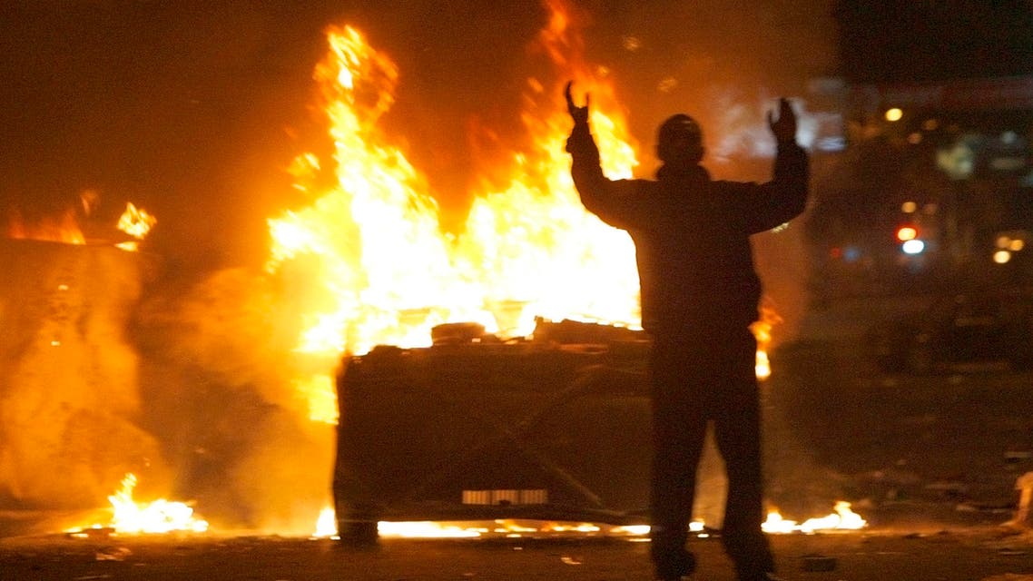 A protester reacts near burning police cars in central Yerevan March 2, 2008. (Reuters)