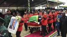 Tanzania buries COVID-19 skeptic late president, successor mourns 'hero'