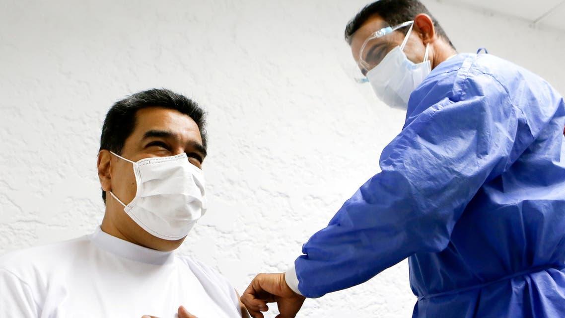Venezuela's President Nicolas Maduro receives a dose of the Sputnik V coronavirus disease (COVID-19) vaccine in Caracas, Venezuela March 6, 2021. Miraflores Palace/Jhonander Gamarra/Handout via REUTERS ATTENTION EDITORS - THIS PICTURE WAS PROVIDED BY A THIRD PARTY. NO RESALES. NO ARCHIVES