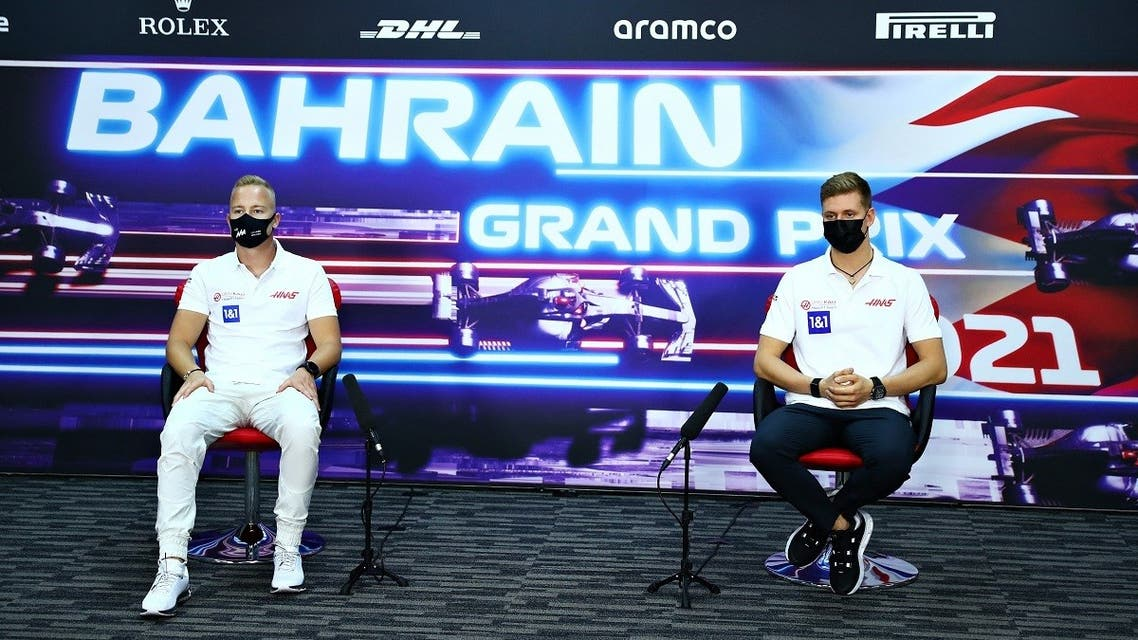 Haas F1's Russian driver Nikita Mazepin (L) and Haas F1's German driver Mick Schumacher attend the presser ahead of the Bahrain Formula One Grand Prix in the city of Sakhir on March 25, 2021. (AFP)