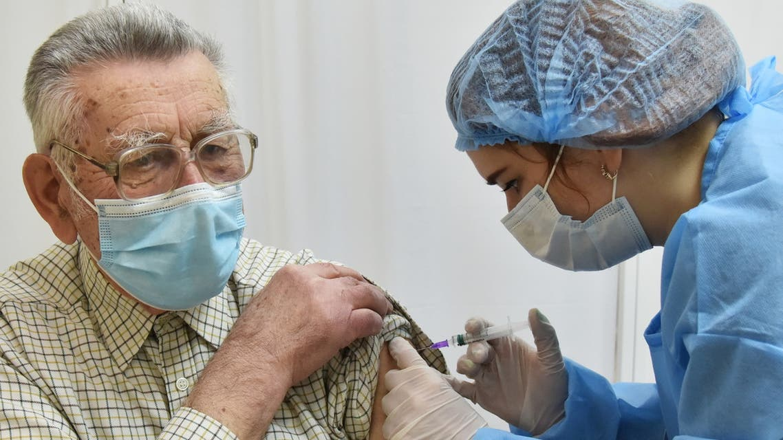 An elderly man receives a dose of the Oxford University/AstraZeneca vaccine against the coronavirus disease (COVID-19), which is produced in India and marketed as Covishield, at a local clinic in Lviv, Ukraine March 24, 2021. REUTERS/Pavlo Palamarchuk