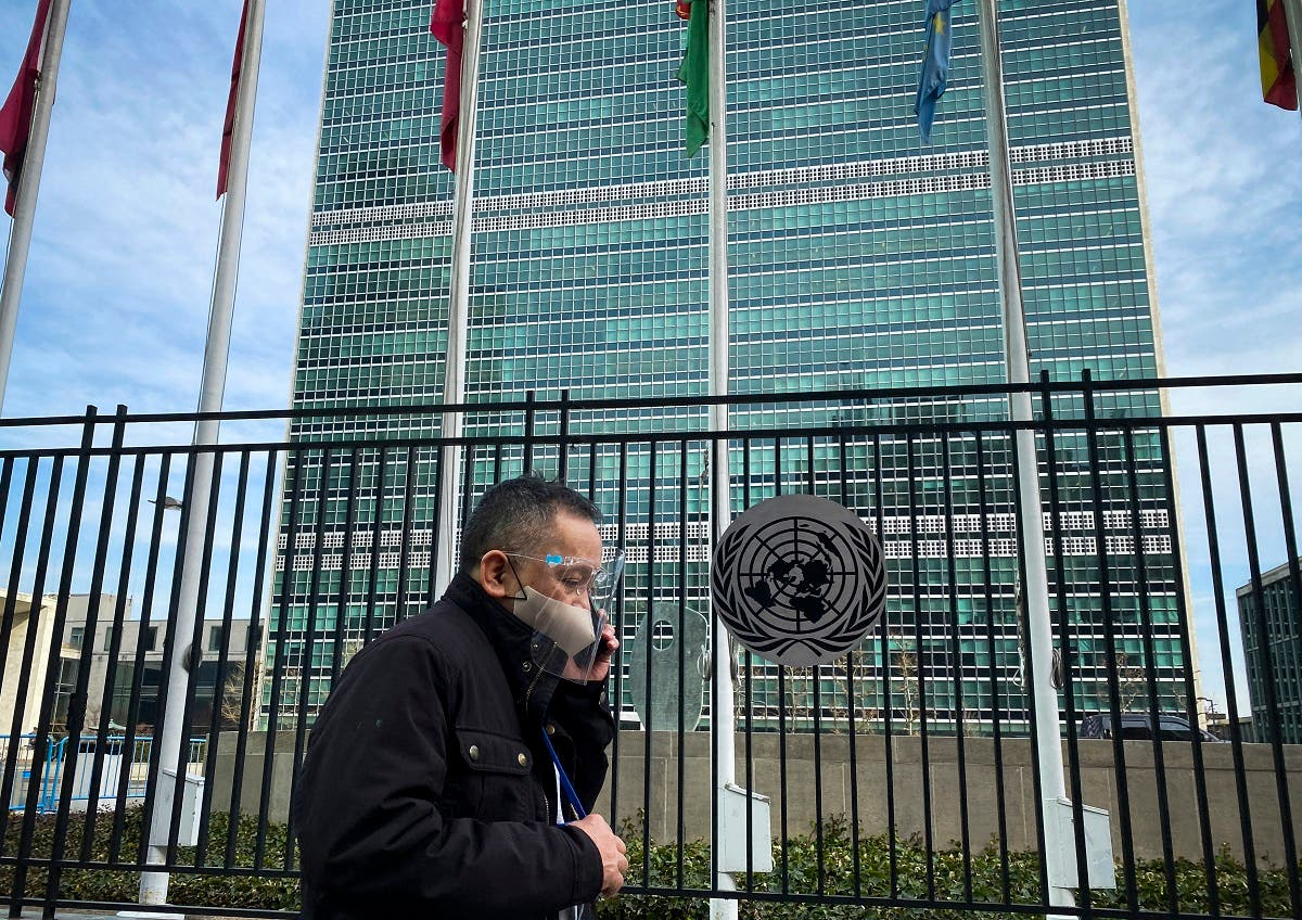 A man walks past the United Nations headquarters in New York on March 11, 2021, one year after the pandemic was officially declared. (AFP)