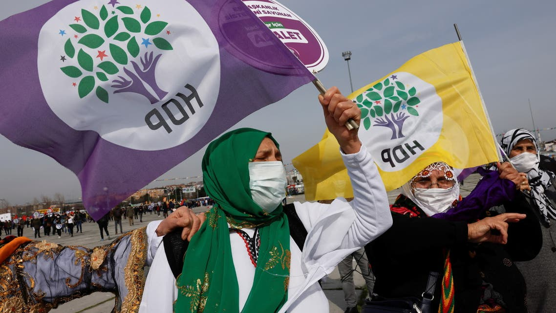 People wave pro-Kurdish Peoples' Democratic Party (HDP) flags during a gathering to celebrate Newroz, which marks the arrival of spring, in Istanbul, Turkey March 20, 2021. REUTERS/Umit Bektas