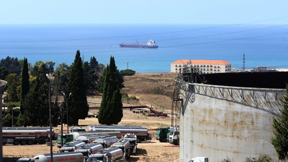 Tanker trucks filled with fuel offered by Iraq wait to empty their content at the oil refinery of Zahrani, near the southerm Lebanese city of Sidon (Saida) on August 20, 2020. (AFP)