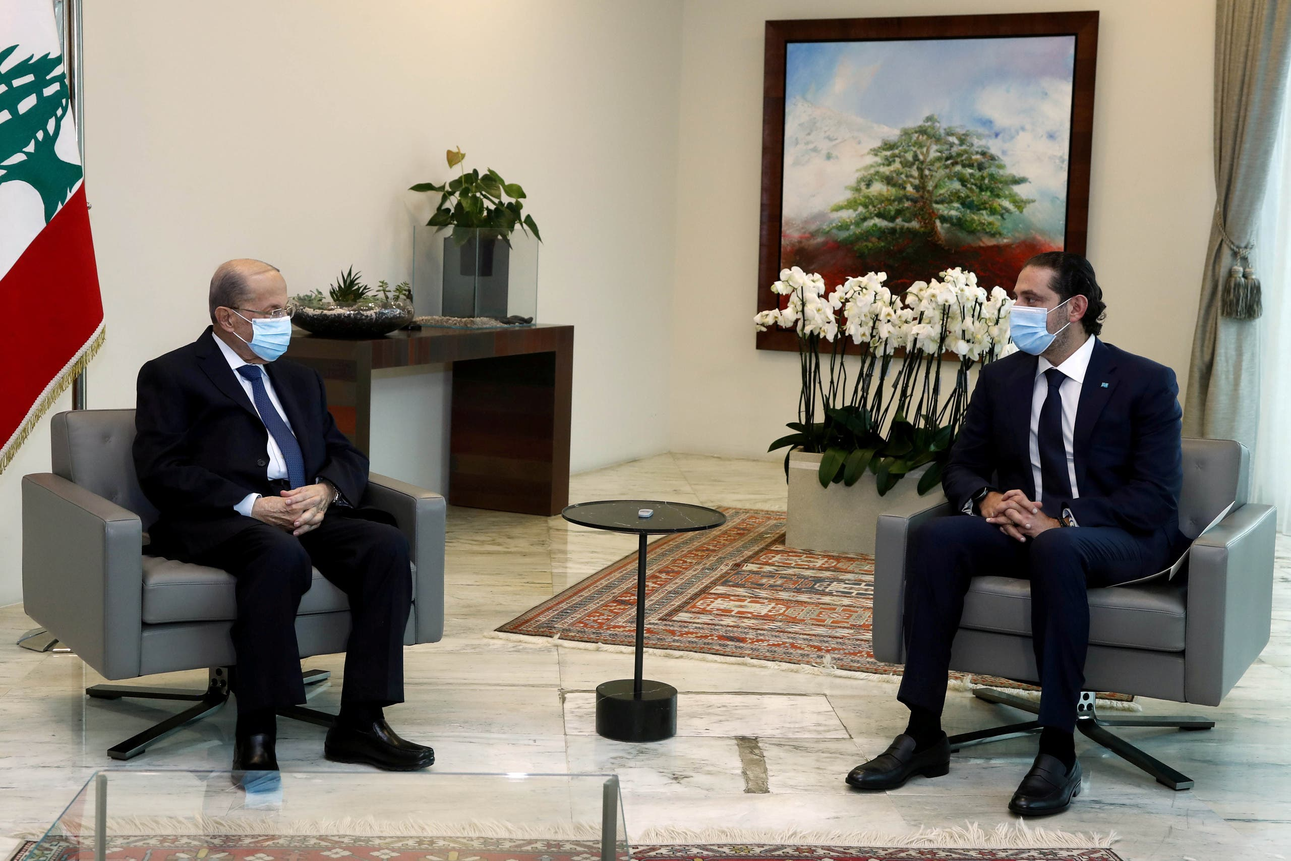 Lebanon's President Michel Aoun meets with Prime Minister-designate Saad al-Hariri at the presidential palace in Lebanon March 18, 2021. (Reuters)